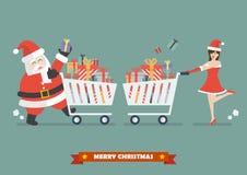 Santa claus and santa woman are purchasing a piles of presents Royalty Free Stock Photo