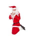 Santa Claus sautant avec le pouce vers le haut du signe Images stock
