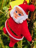 Santa Claus scales the tree. royalty free stock image