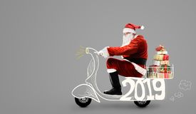 Santa Claus on scooter stock photography