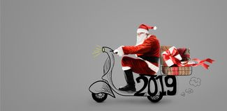 Santa Claus on scooter royalty free stock image