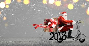 Santa Claus on scooter Stock Image