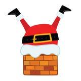 Santa Claus se pegó en la chimenea. Fotos de archivo