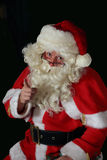 Santa Claus. Seated and pointing with direct eye contact Stock Images