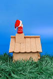 Santa Claus seating on a chimney Royalty Free Stock Images