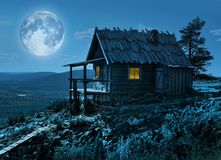Santa`s secret cottage in magic moonlight. Santa Claus secret cottage on Lapland fell top in mysterious moonlight royalty free stock photo