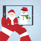 Santa Claus selfie med snögubben Royaltyfri Bild
