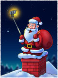 Santa Claus with Selfie Stick Royalty Free Stock Photos