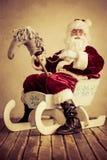 Santa Claus. Senior man against grunge background. Xmas holiday concept Royalty Free Stock Images
