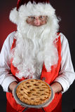 Santa Claus Serving Pie Royalty-vrije Stock Afbeeldingen