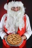 Santa Claus Serving Pie Imágenes de archivo libres de regalías