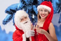 Santa Claus with sexy girl in Santa hat. Stock Photography