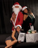 Santa Claus with sexy Girls Royalty Free Stock Photography