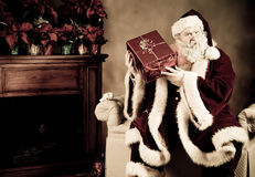 Santa Claus Shaking package Royalty Free Stock Photography