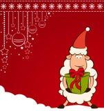 Santa Claus sheep with gift. Stock Photo