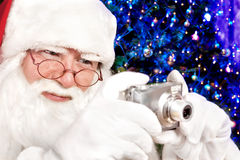 Santa Claus Shoots a Digital Camera Christmas Tree in the Backgr Stock Photos