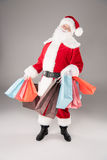 Santa Claus with shopping bags Royalty Free Stock Photos