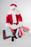 Santa Claus with shopping bags Stock Photos