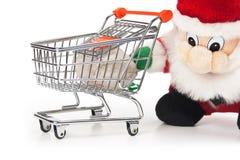 Santa Claus and shopping cart Royalty Free Stock Images
