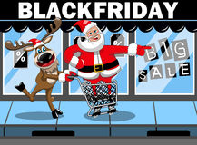 Santa Claus shopping running pushing cart reindeer black friday sale Stock Photo