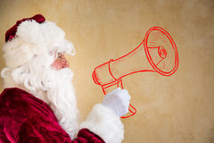 Santa Claus shouting through drawn megaphone. Communication concept Stock Photos