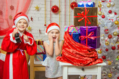 Santa Claus showed the clock Assistant, all the fun smile Royalty Free Stock Image