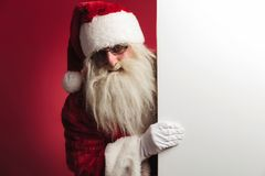 Santa claus showing a big blank board Stock Images
