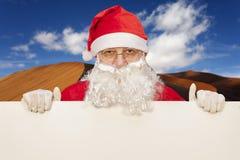 Santa claus showing a blank billboard Stock Photography