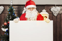 Santa claus showing a blank billboard Stock Images