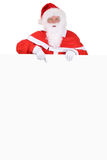 Santa Claus showing on Christmas at empty banner Royalty Free Stock Images