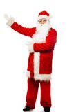Santa Claus showing with gestures something Royalty Free Stock Photos