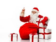 Santa Claus showing with gestures something Stock Photography