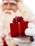 Santa Claus showing gift Stock Image