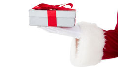 Santa claus showing gift with red ribbon. On white background Stock Images