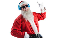 Santa claus showing hand yo sign while listening to music on headphones Royalty Free Stock Photos