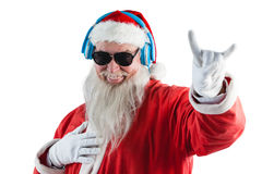 Santa claus showing hand yo sign while listening to music on headphones Royalty Free Stock Photography