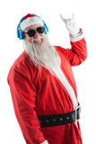 Santa claus showing hand yo sign while listening to music on headphones Stock Photos