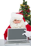 Santa claus showing his laptop. On white background royalty free stock images