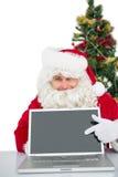Santa claus showing his laptop Royalty Free Stock Images