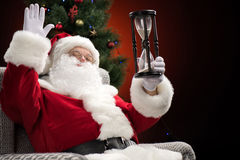 Santa Claus showing hourglass Royalty Free Stock Photography