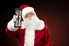 Santa Claus showing hourglass Stock Photography
