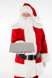 Santa Claus showing laptop. Computer on white stock images