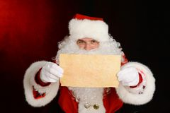 Santa Claus showing a letter stock photo