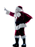 Santa claus showing pointing silhouette isolated Royalty Free Stock Photo