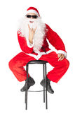 Santa Claus showing the rocker hand sign and smoking a cigar Royalty Free Stock Photo