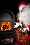Santa Claus showing the stove Stock Photos