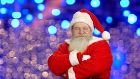 Santa Claus showing thumbs up. Santa, bright lights background stock footage