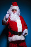 Santa Claus showing the thumbs up gesture Stock Image