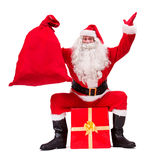 Santa Claus shows Christmas gift Royalty Free Stock Photography