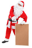 Santa claus shows empty bulletin board Royalty Free Stock Photos